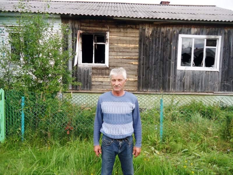 В п. Тужа храбрый сосед спас из огня женщину.